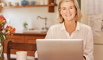 Smiling Senior Woman with a Laptop